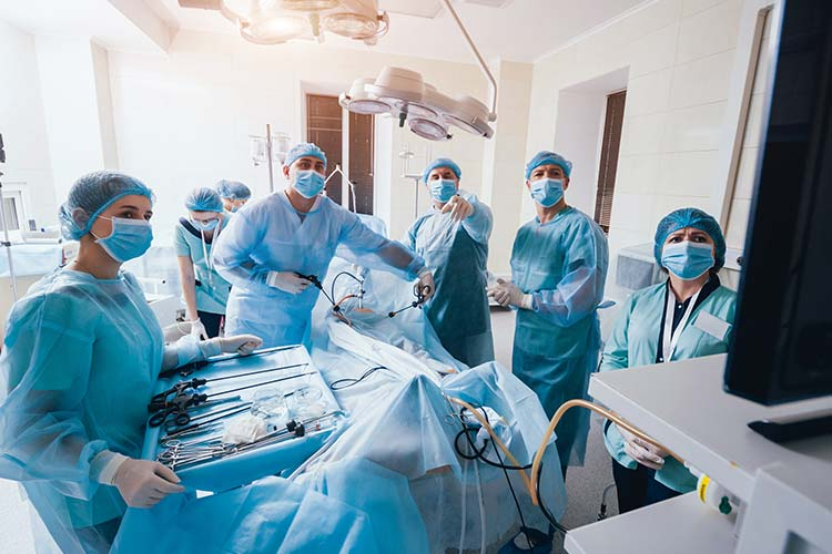 doctors performing surgery using a scope